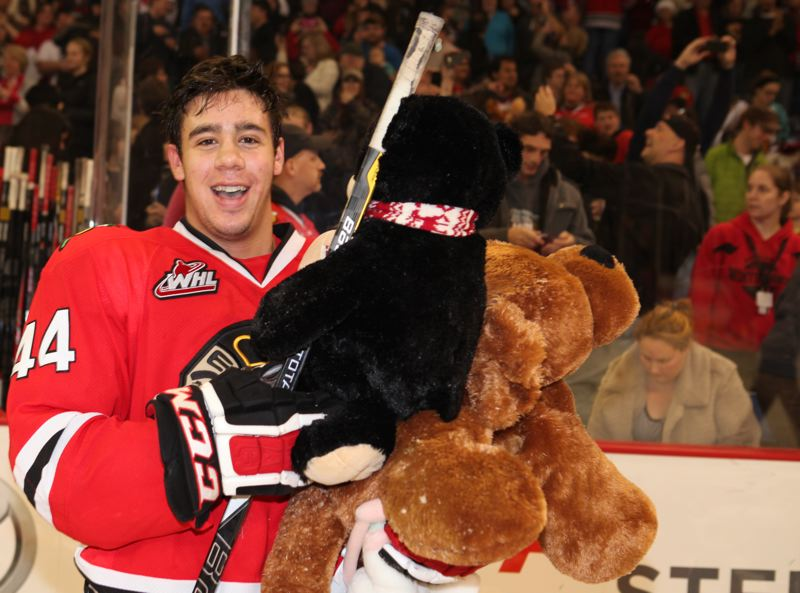 by: COURTESY OF PORTLAND WINTERHAWKS - Portland Winterhawks defenseman Keoni Texeira picked up his first Western Hockey League goal - and some teddy bears for needy children - last Saturday before a sellout crowd at Memorial Coliseum.