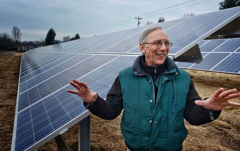 by: RAY HUGHEY - Mike Bondi talks about the potential the new solar panel array has for the North Willamette Research and Extension Center in Aurora.
