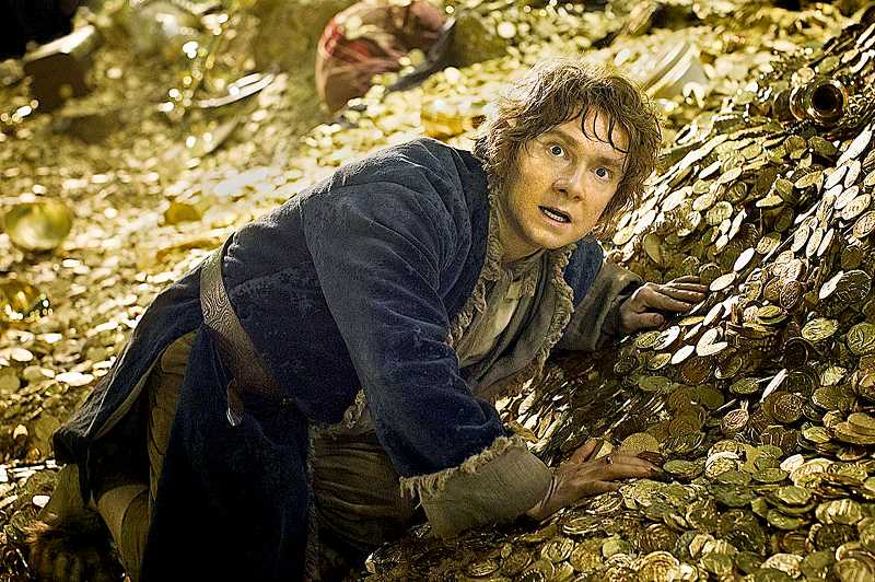 by: PHOTO COURTESY OF LIONSGATE - Film open -- Bilbo Baggins (Martin Freeman) faces Smaug in the Lonely Mountain during the second installment in the Hobbit series, 'The Hobbit: The Desolation of Smaug. The film opened Dec. 13.