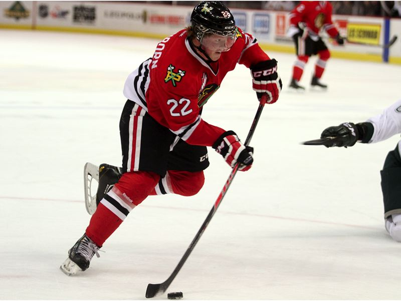 by: TRIBUNE PHOTO: JONATHAN HOUSE - Alex Schoenborn of the Portland Winterhawks takes a shot against Everett.