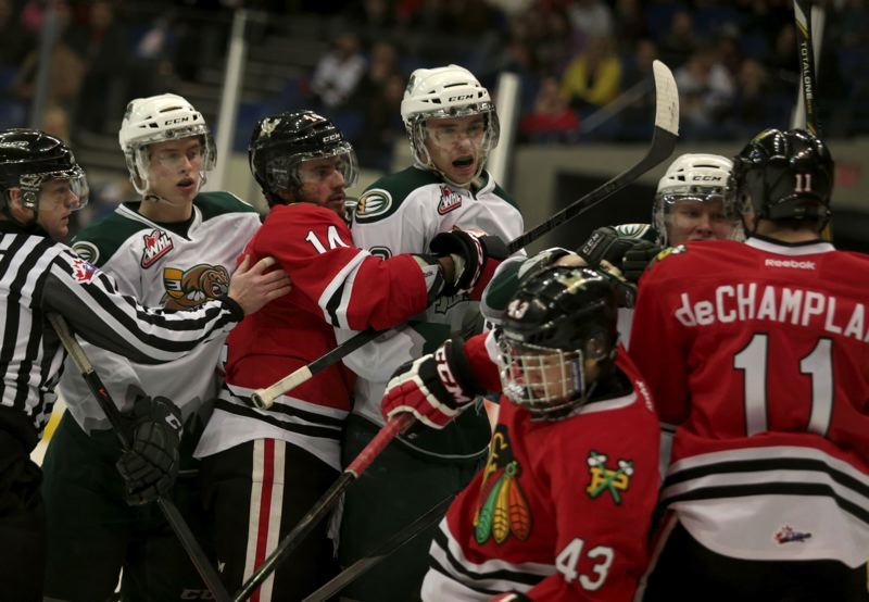 Portland Winterhawks (from left) Shane McColgan, Skyler McKenzie and Adam deChamplain get rowdy with assorted Everett Silvertips.