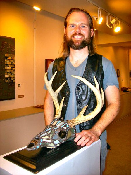 by: RITA A. LEONARD - Glass artist James Nickerson won a first place award for this leaded glass deers skull entitled Gifts of the Paternal Gene.