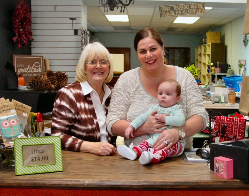 by: MERRY MACKINNON - Lynn Banta (Rachel Herrons mother), Rachel Herron, and Elsie Herron will be greeting customers at The Flower Shop in Woodstock during the Holidays. But at the end of January, the shop will be closed and Grand Central Bakery will move in.
