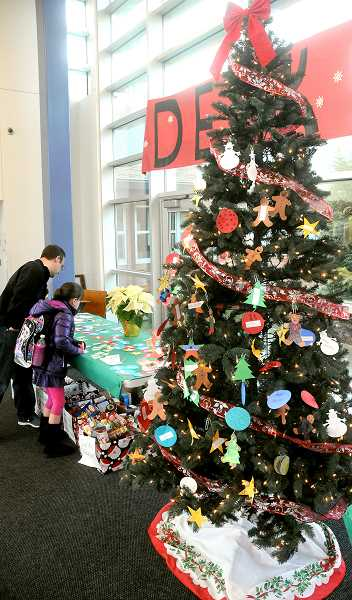 by: SETH GORDON - Giving back   to the community - Mabel Rush Elementary joined other schools in the Newberg School District in holding canned food drives and 
