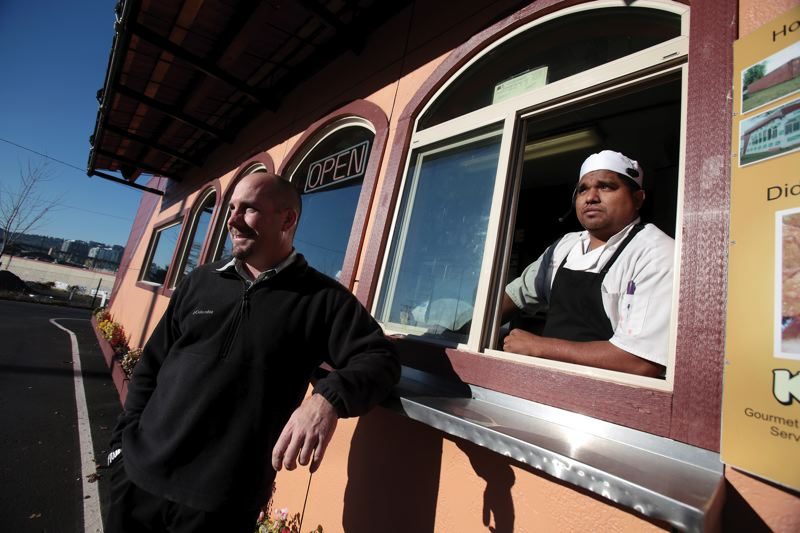 by: PAMPLIN MEDIA GROUP: JONATHAN HOUSE - Aprisas Kirk Lance (left) and Pedro Garcia offer a take-out Mexican restaurant in a converted cargo container parked near Southeast Eighth Avenue and Division Street.