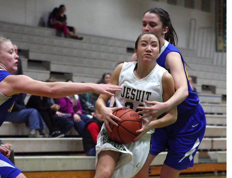 by: TIMES FILE PHOTO - Jesuit guard Keara Vu has taken over as one the Crusaders best defensive players in the preseason.
