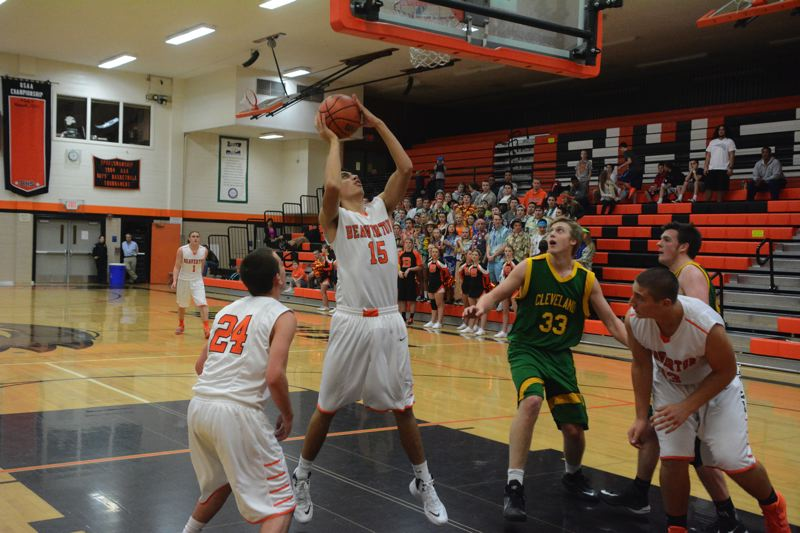 by: TIMES PHOTO: MATT SINGLEDECKER - Beaverton senior power forward Kiuna Talalemotu puts up an offensive rebound for two against Cleveland.