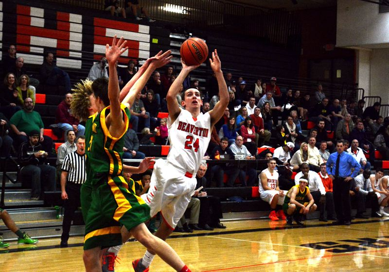 by: TIMES PHOTO: MATT SINGLEDECKER - Beaverton junior guard Nate Sweet floats past a pair of Cleveland defenders for an off balance basket.