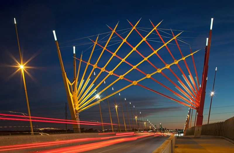 by: FILE PHOTO - The Forest Grove Library Foundation is raising money to pay for a public art piece featuring a colored-glass design by nationally-renowned artist Ed Carpenter, whose sculptures adorn structures across the country, including this bridge in Council Bluffs, Iowa.