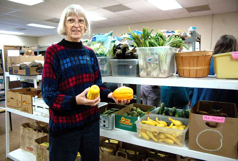by: ISABEL GAUTSCHI - Barbara Shibley, director of the Estacada Area Food Bank, shows off some fresh produce available for clients.