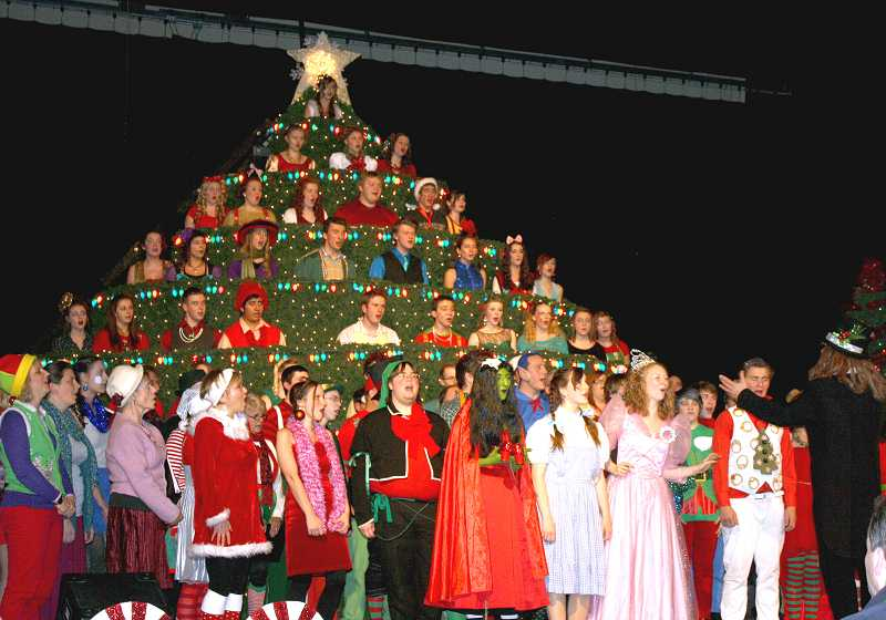 by: PEGGY SAVAGE - The closing number of the Singing Christmas Tree, with a few cast and chorus members from Molalla high school, middle school, community and alumni choruses.