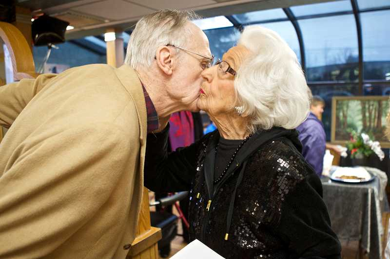 by: TIMES PHOTO: JAIME VALDEZ - Jack Leonard kisses her friend, Ardith Tall, during Tall's 95th birthday at McDonald's restaurant in Beaverton along Southwest Beaverton-Hillsdale Highway.