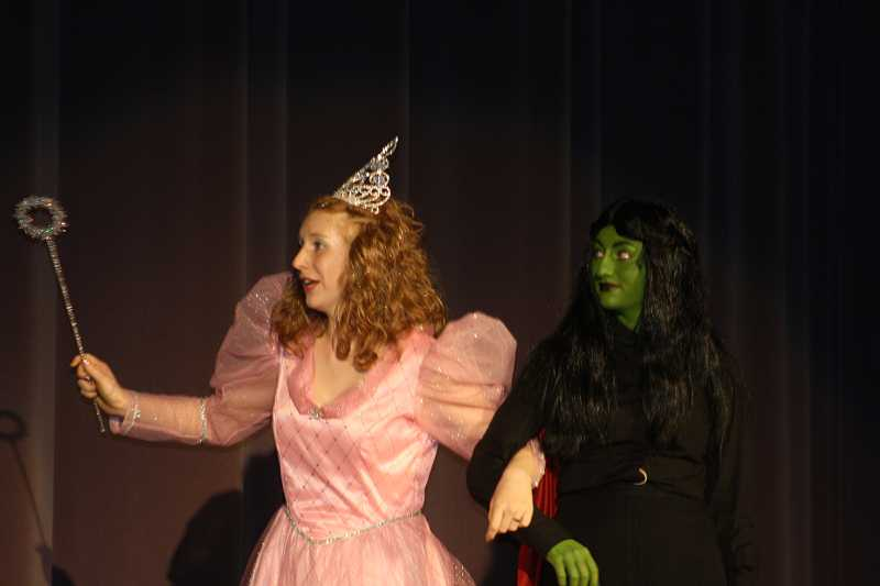 by: PEGGY SAVAGE - Glinda and the witch, played by Jennifer Paulsen and Kealee Wong