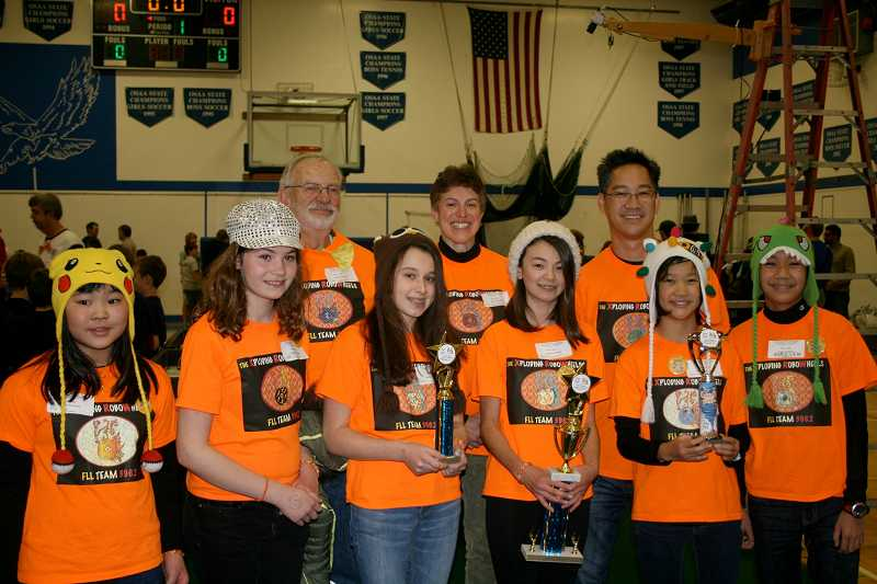 by: SUBMITTED PHOTO - The Xploding RoboWheels were among several robotics teams from Lake Oswego that were successful at recent competitions. Team members, from left, front row, are: Kira Takara, Natalie Peterman, Katie Oppenheimer, Larissa Chan, Sera Lew and Ryan Lew; and, back row, from left: coaches Dale Kresge, Lillian Oppenheimer and Ron Lew.