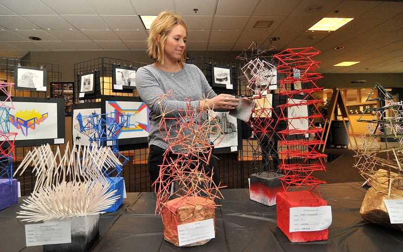 Westside art teacher Chelsea Witkowski prepped for the Christmas Concert and Winter Art Show, which was held Monday.