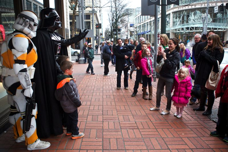 by: TRIBUNE PHOTO: JAIME VALDEZ - Darth Vader and his Imperial Stormtroopers stop holiday shoppers in their tracks outside Macy's in downtown Portland.