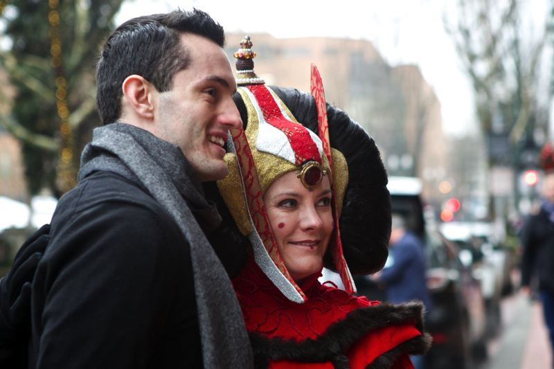 by: TRIBUNE PHOTO: JAIME VALDEZ - Jedidiah Maxwell of Canby has his picture taken with Queen Apailana in downtown Portland.