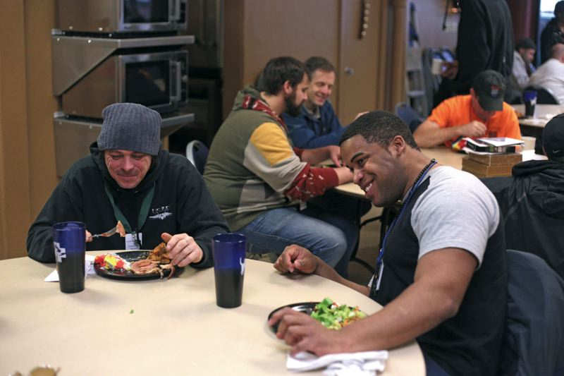by: TRIBUNE PHOTO: JONATHAN HOUSE - Vinson Lakey and Tasson Billings share a laugh over lunch at the Portland Rescue Mission in downtown Portland. The two are part of the organizations Link Program, aimed at getting men off the street and onto a career path.