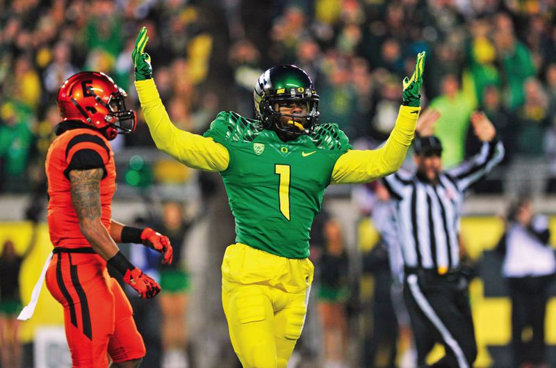 by: COURTESY OF JOHN LARIVIERE - Oregon Ducks receiver Josh Huff celebrates one of his three touchdown catches against Oregon State in the Civil War game at Autzen Stadium.