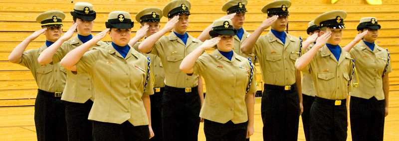 by: LON AUSTIN/CENTRAL OREGONIAN - Members of the Crook County High School NJROTC unarmed drill team salute near the beginning of their performance Saturday at their home competition on Saturday. The unarmed drill team easily won their portion of the competition.