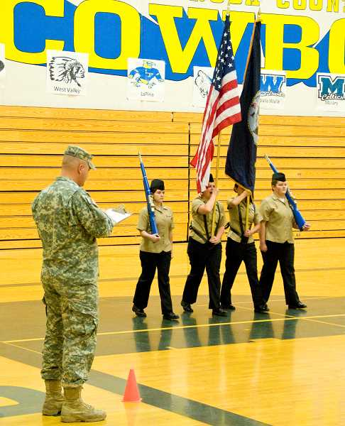 by: LON AUSTIN/CENTRAL OREGONIAN - Members of the CCHS No. 1 color guard (Hannah Shadle, Veronica Reyes, Payton Nolin, and Jessica Stanley parade before one of the judges during Saturday's competition. The team finished fourth in the competition while the No. 2 color guard won their division.