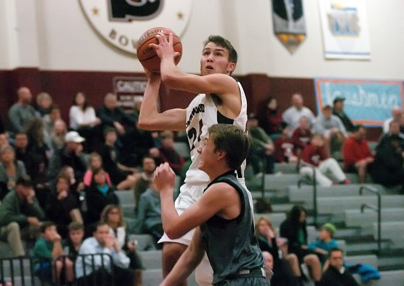 by: DAN BROOD - FLOATING -- Sherwood High School senior Cortland Hutchison goes up high to take a shot during Tuesday's game. The Bowmen downed West Salem 57-40 to stay unbeaten on the season.