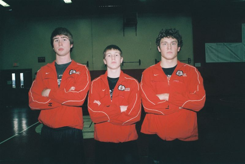 by: JOHN DENNY - Oregon City senior leaders (from left) Tanner Fischer, Devin Poppen and Michael Griffin believe the Pioneers have the horses to do some damage at the state tournament again this season. All three wrestlers placed high at the 2013 State Tournament, as they helped the Pioneers earn second place in the state-meet team scoring, the highest team placing in school history.