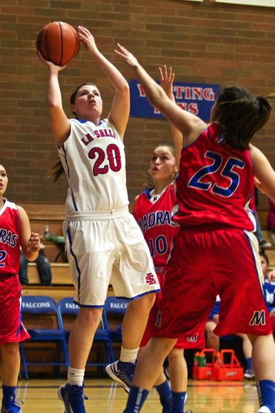 by: TRIBUNE FILE PHOTO: JAIME VALDEZ - Morgan McSmith puts up a shot in last year's Tri-Valley Conference home game with Madras. Sporting a veteran lineup that includes a host of experienced players from last year's team that placed fourth at state, the Falcons plan on making a run at a state title this winter.