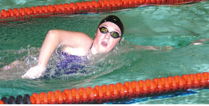 by: SANDY POST: PARKER LEE - Sandys Cherie Schaffer takes a breath during her photo-finish win in the 100 freestyle Thursday.