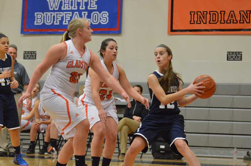 by: JEFF GOODMAN - Wilsonville freshman Kristen Burke (right) is trapped by Gladstone juniors Alicia Feb (left) and Melisa Campos during a nonleague game Dec. 19. The Wildcats were held without a point in the third quarter.