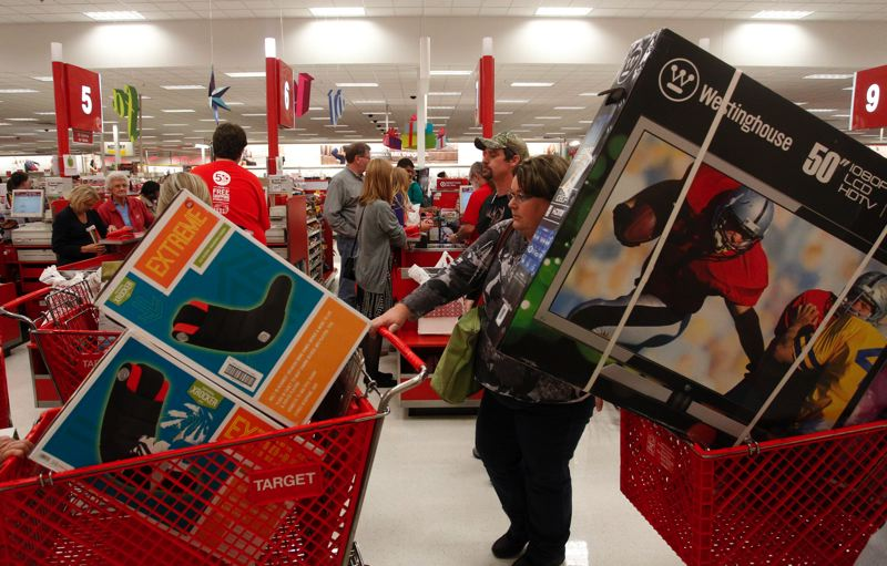 by: COURTESY OF TARGET CORP. - Black Friday shoppers lined up at a Target store's check-out stand with their merchandise. The Minnesota corporation said about 40 million customers may have been affected by a credit card security breach between Nov. 27 and Dec. 15.
