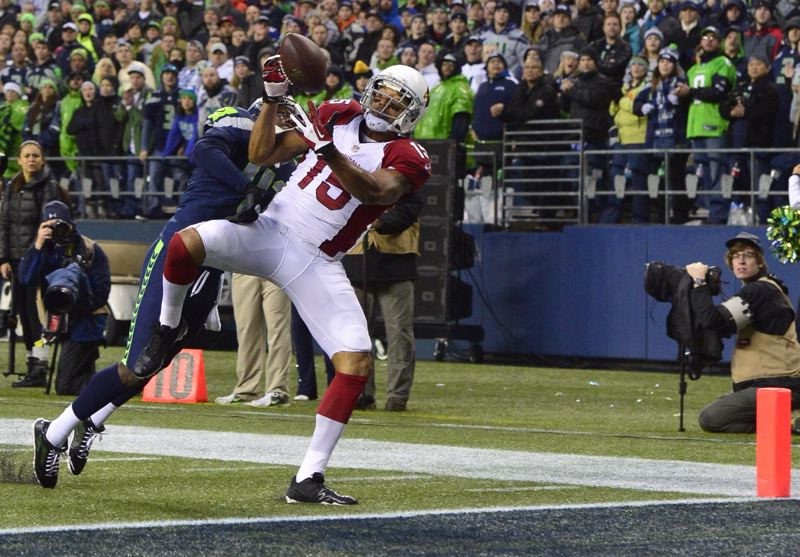 Arizona Cardinals receiver Michael Floyd hauls in the winning touchdown catch Sunday at CenturyLink Field.
