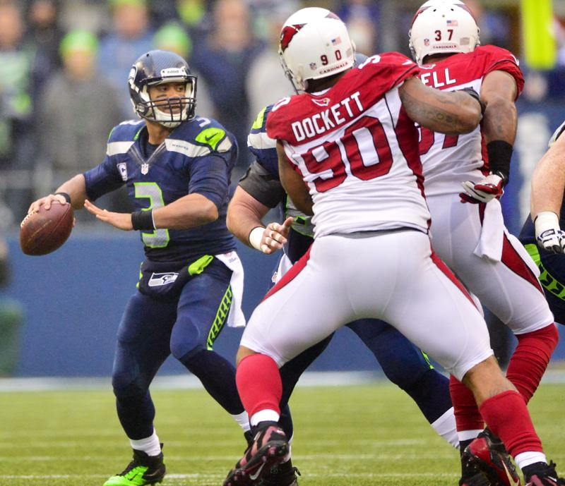 Arizona's pass rush puts some heat on Seattle quarterback Russell Wilson.