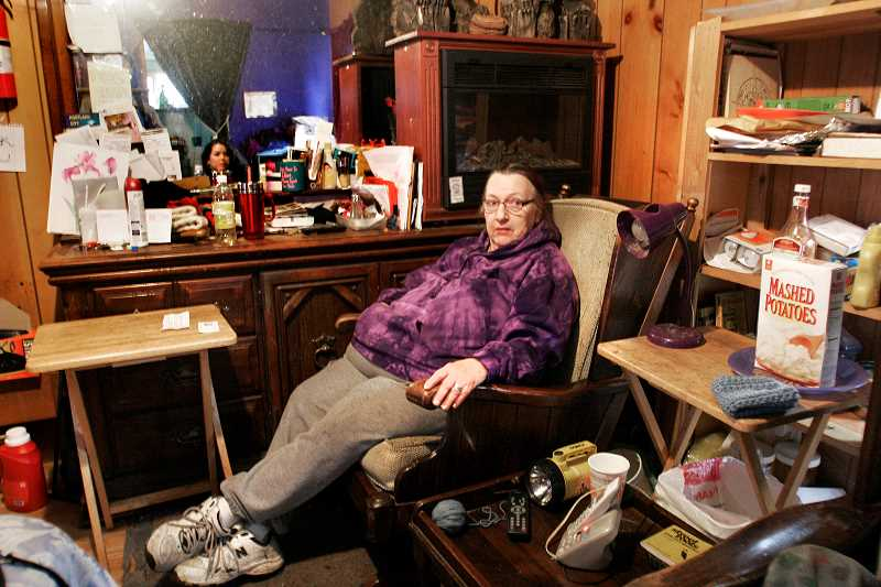 by: JIM CLARK - Ethel 'Punki' McNamee maintains living conditions are 'perfect' in the house and outbuildings of her residence in the 200 block of Northeast Pierce Street.