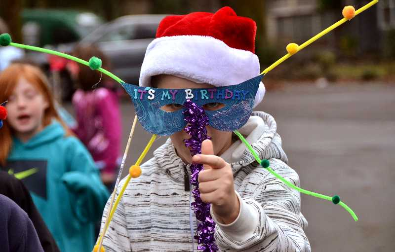 by: TIDINGS PHOTO: VERN UYETAKE - Fourth-grader Nate Watton has more to celebrate than giving. His mask reads, 'Its my birthday.'