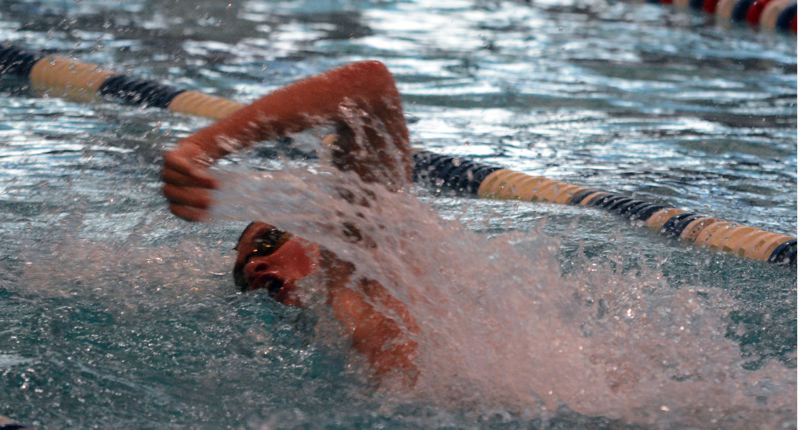 by: TIMES PHOTO: MATT SINGLEDECKER - Southridge junior boys' swimmer Matt Braun won the 50 and 100 yard freestyle against Jesuit.