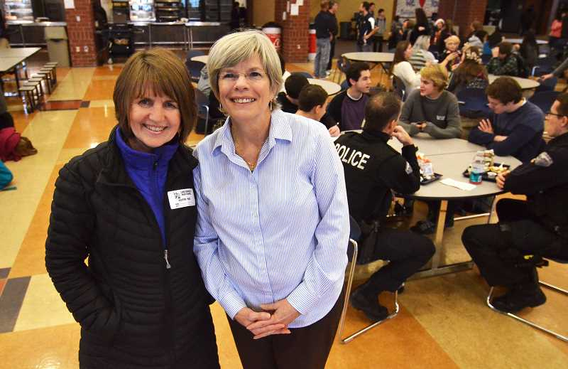 by: VERN UYETAKE - Becky Cartier, left, got the enthusiastic support of Marcie Christianson, Lake Oswego School District food services director, on her program that brings together police officers and local students.