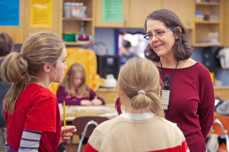 by: TIMES PHOTO: JAIME VALDEZ - Janice Avidan teaches math to fourth-graders at Buckman Elementary School. She's one of about 100 Portland Public Schools teachers who filed to retire last week, the highest number of retirees in several years.