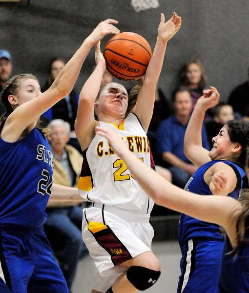 by: SETH GORDON - Closing in -- Remy Brentano (left) and Carolina Ruvalcaba converge on C.S. Lewis guard Katelyn Reimer during St. Paul's 51-13 victory Dec. 17. Brentano scored 11 points for the Buckaroos.