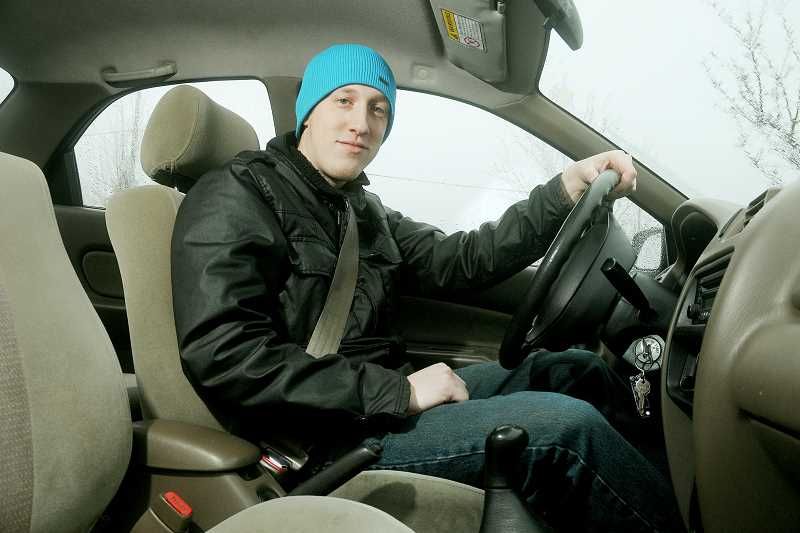 by: GARY ALLEN - On the go -- Travis Reinhardt, owner of Newberg Grub 2 Go, is      currently the only business' employee. With his car as his office, Reinhardt runs a food delivery service.