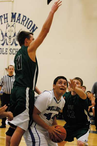 by: PHIL HAWKINS - Woodburn junior Leo Garza