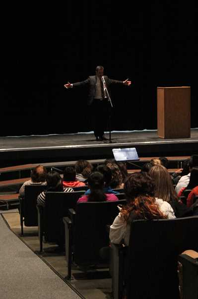 by: LINDSAY KEEFER - Joaquin Zihuatanejo, a Poetry Slam international winner, spoke at Woodburn High School (right), among other schools, Dec. 17.