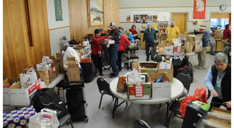 by: PHOTO BY BILL VOLLMER - United Methodists fill boxes.