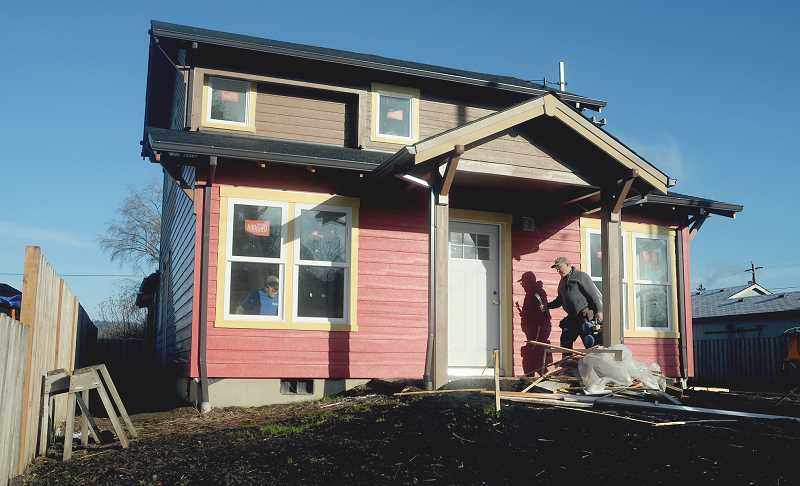 by: GARY ALLEN - Cold weather has pushed back the completion dates of three Habitat for Humanity homes on East Ninth Street, but Lisa Thompson, Habitat spokeswoman, said they hope to open one each month starting in January.