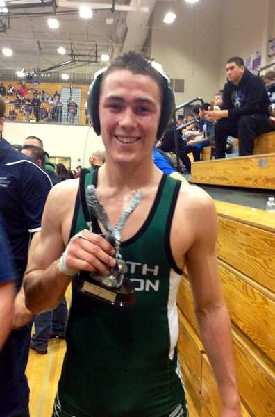 by: FACEBOOK PHOTO - North Marion freshman Lane Stigall poses with his trophy after winning the 145-pound bracket Dec. 21 at the Oregon National Guard Invitational tournament at Liberty High School in Hillsboro.