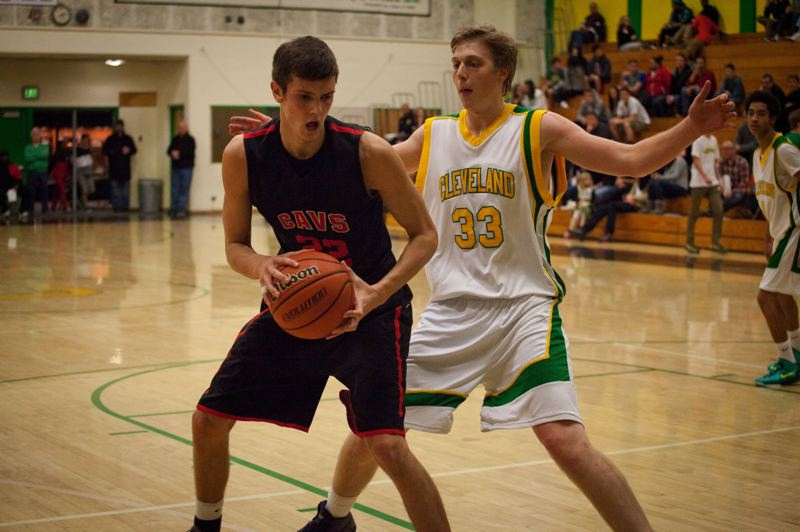 by: TRIBUNE PHOTO: ADAM WICKMAN - Cleveland post Alex Sparks (right) closes out on Clackamas' 	Keaton Bankofier in a non-league Warriors home game.