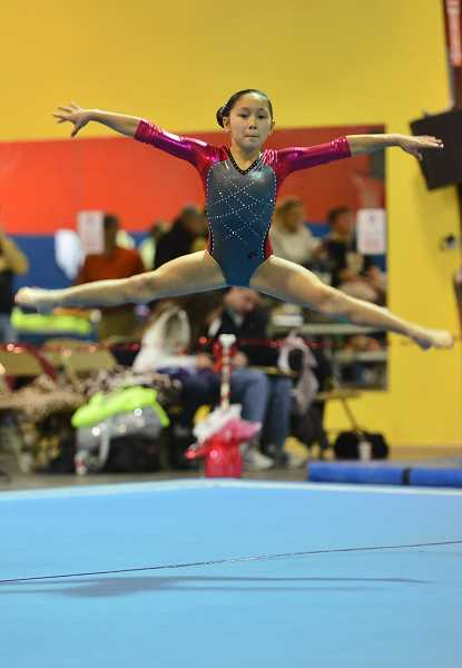 by: SUBMITTED PHOTO - Kara Harper competes in floor exercise during the Fall Compulsory State Gymnastics Championships, which wrapped up Dec. 8 in Grants Pass. Harper, who attends Lee Elementary School in Canby, won her division.