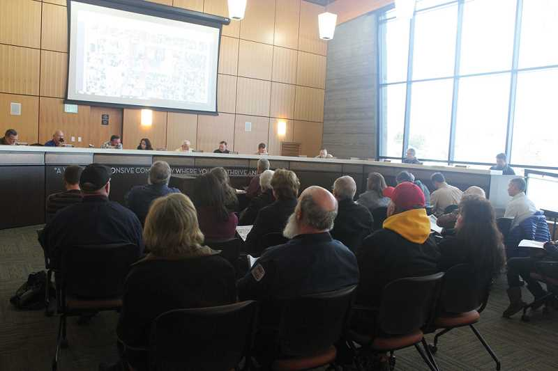 by: HOLLY M. GILL - Property owners filled every chair at the Dec. 20 meeting of the Madras City Council on the U.S. Highway 97-J Street realignment access plan.
