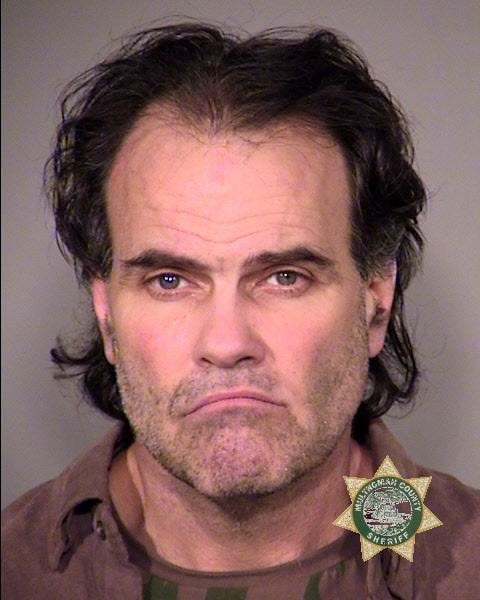by: PORTLAND POLICE BUREAU - Robert Joseph Leonard was arrested on Christmas Eve for allegedly stealing packages off of porches in the Irvington neighborhood.