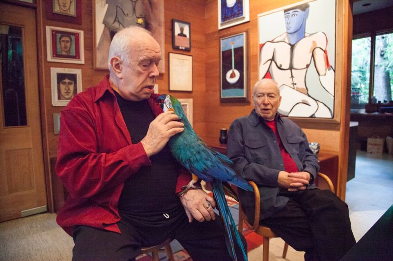 by: DAN SADOWSKY/OPB - Eric Marcoux (left) and Eugene Woodworth live in Northwest Portland in a home they built in 1969 that they share with a 34-year-old macaw.